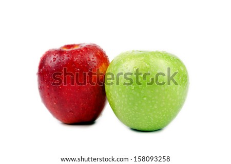 Green and red apples with water drops. Isolated on a white background. - stock photo