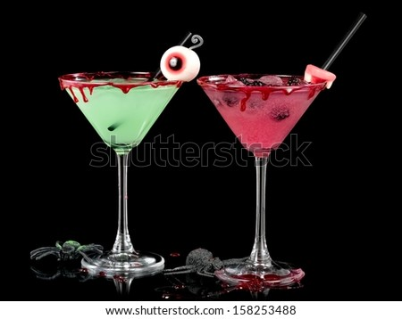 Green and red bloody Halloween cocktails in martini glasses - stock photo
