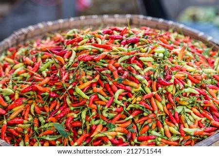 Green and red chillies displayed in a market in Kota Kinabalu, Malaysia - stock photo