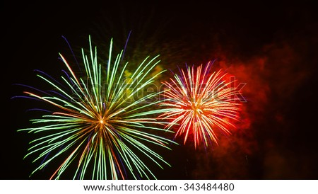 green and red fireworks by night - stock photo