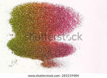 Green and red glitter on light background - macro photo - stock photo