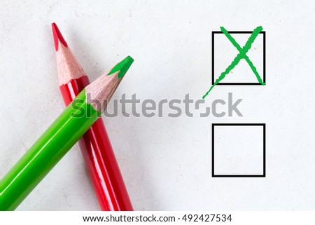 Green and red pencils with marking checkbox. Concept for customer satisfaction survey,education research or election