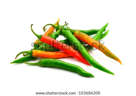green and red pepper is isolated on a white background