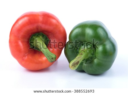 Green and red  pepper on white background