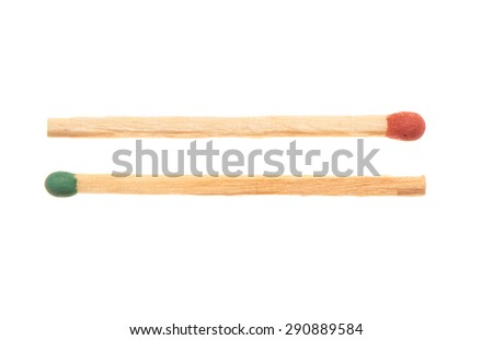Green and red wooden matches lying in opposite directions, isolated on white background - stock photo