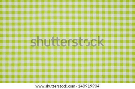 Green and white checkered tablecloth - stock photo