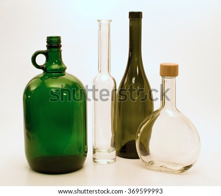 Green and white glass bottles of different shapes