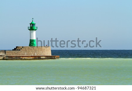 Green and white lighthouse on the Island of Rügen in Germany - stock photo