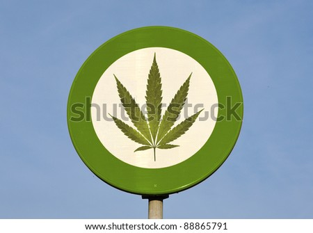 Green and white round reflective sign with Cannabis leaf