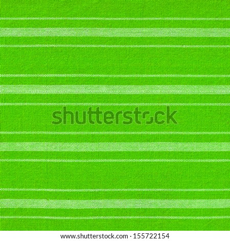 Green and white stripes fabric background - stock photo