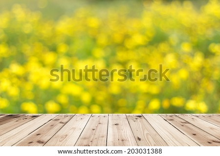 green and yellow  bokeh and sunlight with wood floor - stock photo