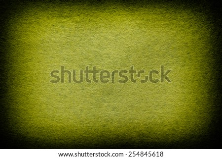 Green and yellow felt background. Vignette. - stock photo