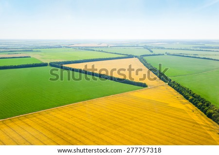Green and yellow fields from above aerial view - stock photo