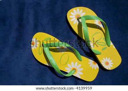green and yellow flip-flops - summer and beach concepts - stock photo