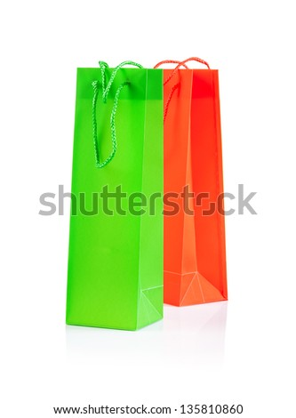 green and yellow paper bags isolated on white