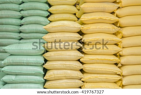 green and yellow sacks of rice.