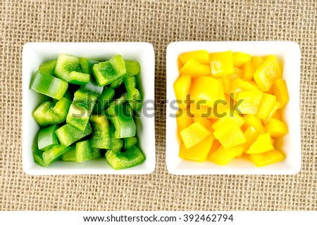Green and yellow vegetarian pepper vegetables in square containers - stock photo