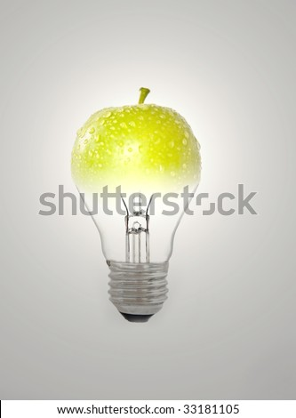 Green apple and bulb - stock photo