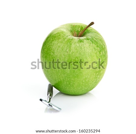 Green apple and dental tools isolated on white - stock photo