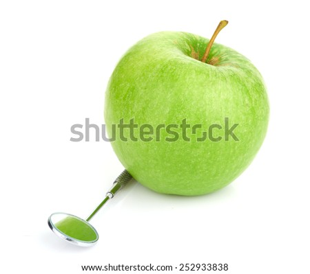 Green apple and dental tools isolated on whitedental; concept; pain; isolated; protective; tooth; green; white; tool; treating; diet; clinic; oral; service; clean; treatment; probe; equipment; mirror
