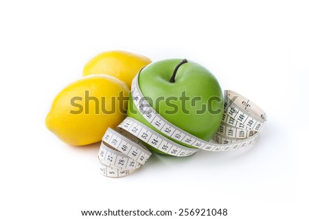 green apple and lemon with measuring tape isolated on white background  - stock photo