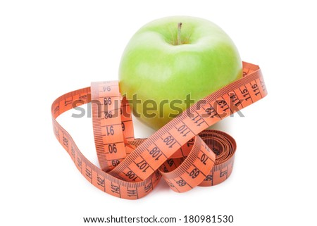 Green apple and measure tape.Isolated