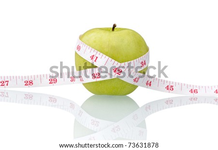 green apple and measure tape isolated on white with reflection