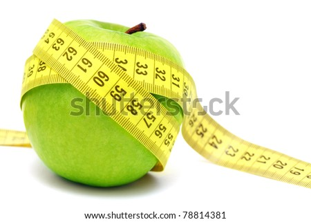 Green apple and measuring tape isolated on white background - stock photo