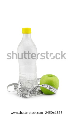 Green apple and measuring tape isolated on white. Exercise sport  and healthy diet concept. - stock photo