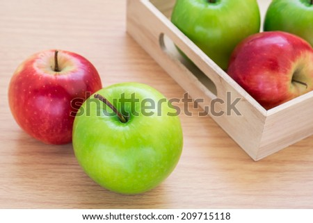 Green apple and red apple - stock photo