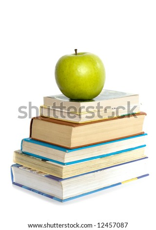 Green apple and stack of books