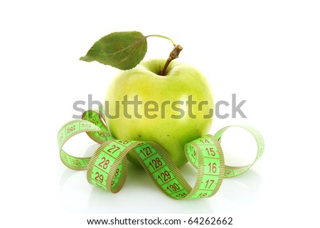 Green apple and tape measure close up