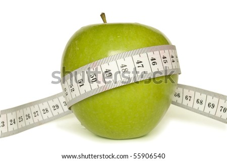 green apple and tape measure isolated on white