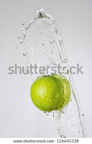 Green apple and water splash