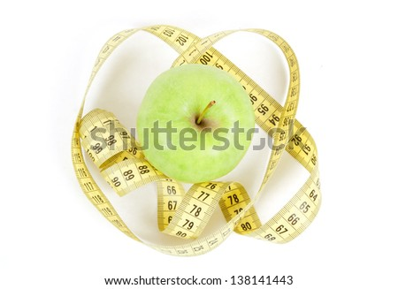 Green apple and yellow measuring tape isolated on white background
