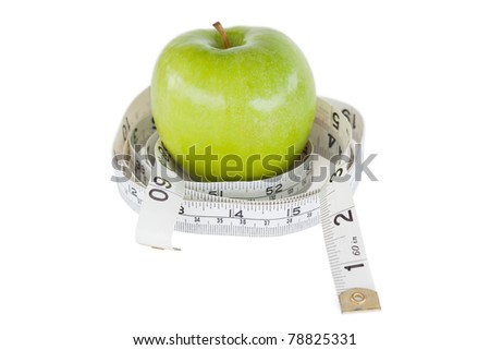 Green apple circled with a tape measure against a white background