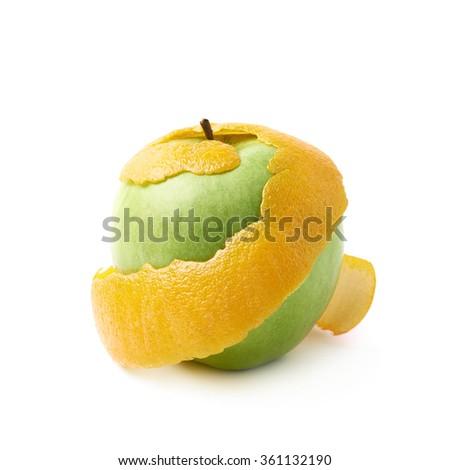 Green apple covered with orange peel - stock photo