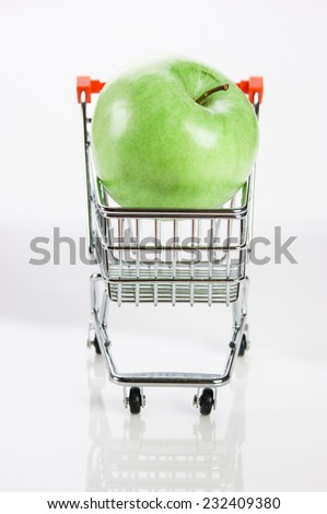 green apple in shopping carts  - stock photo