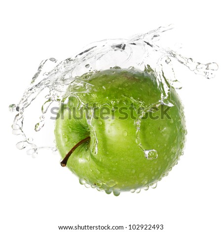 Green apple in splash of water isolated on white background