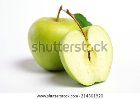 green apple in the context - stock photo