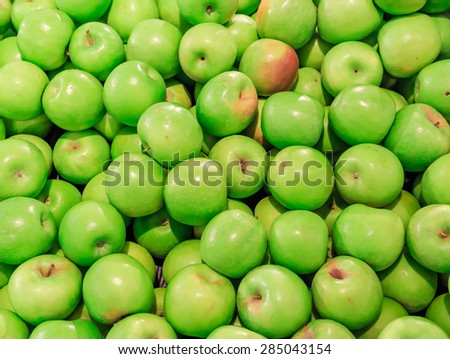 green apple in the market background and textures - stock photo