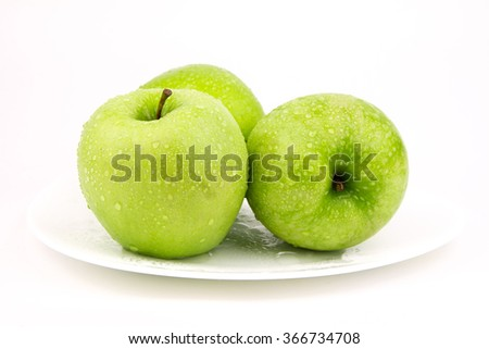 Green apple, isolated on white background / Green apple with droplet / A ripe green apple. Isolated on white - stock photo