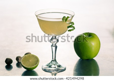 green apple lime spice cocktail classic zest rum vodka  - stock photo