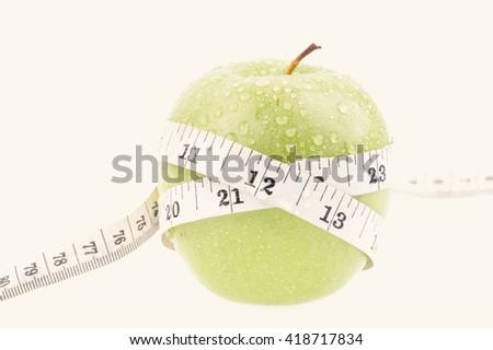Green apple measured the meter - stock photo