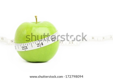 Green apple measured with measuring tape on white background, Diet concept