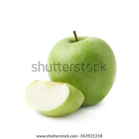 Green apple next to a slice isolated - stock photo