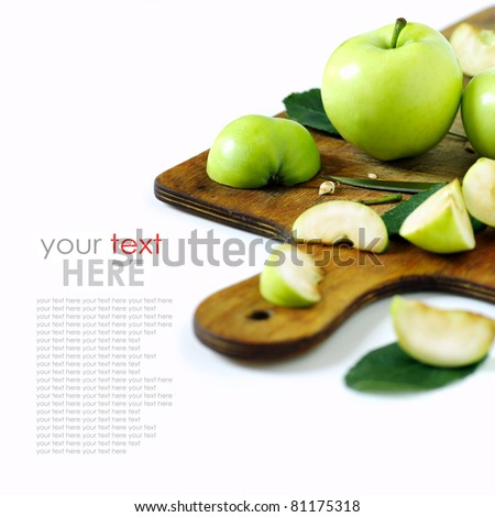 green apple on a kitchen cutting board. isolated on a white background - stock photo