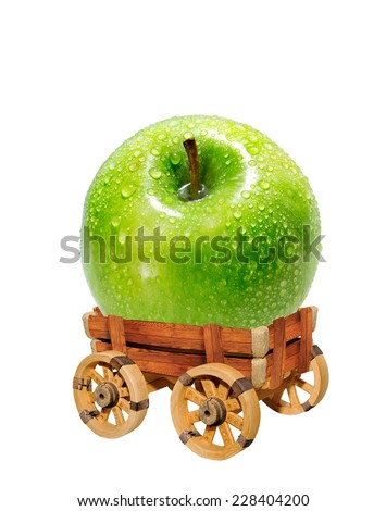 Green apple on a rustic wain.Fruit on a white background. - stock photo