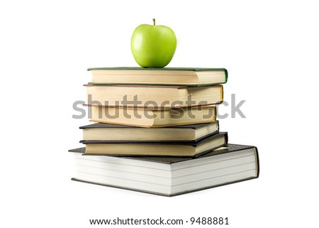 Green apple on books. Isolated on white