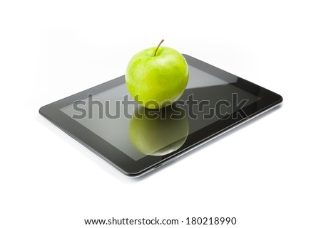 green apple on digital tablet pc on white background, concept of learn new technology - stock photo
